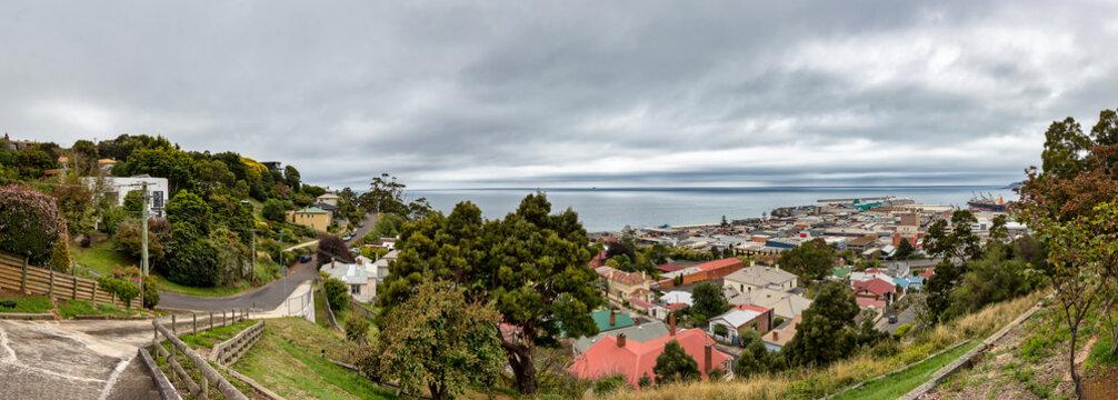 Panoramic view of the city center and port of Burnie, Tasmania over a dramatic sky, Australia.