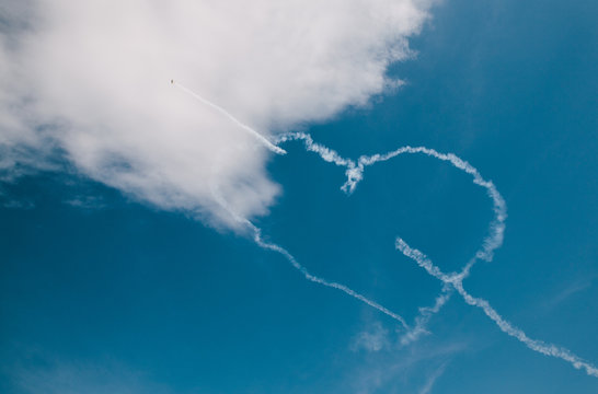 Heart Shaped Vapor Trail Of Airplane In Sky