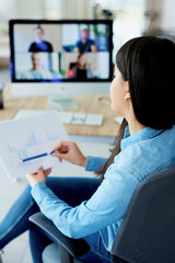 Vertical photography of woman having video conference