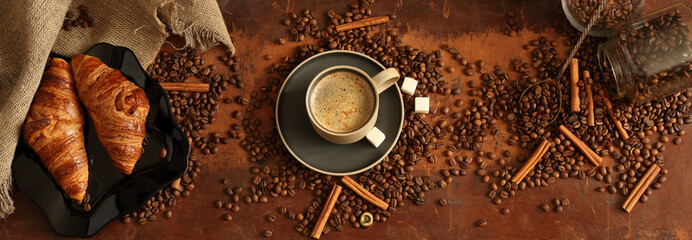 Panorama with a Cup of coffee, coffee beans and croissants in retro style