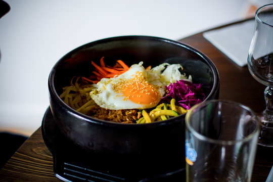 Close-up Of Bi Bim Bap Served In Container On Table