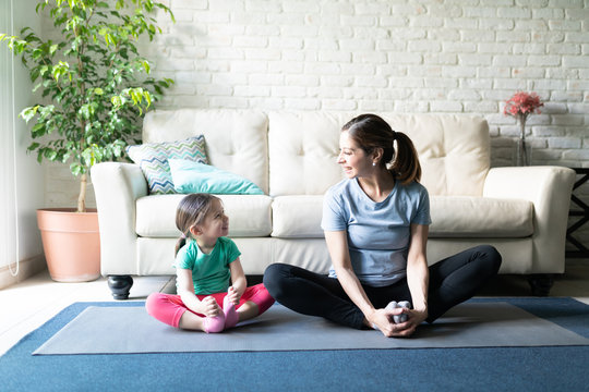 Mom and daughter exercising together