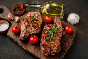 Canvas Prints two grilled beef steaks with spices on a stone background
