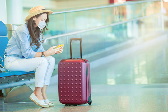 Young tourist woman with baggage in international airport