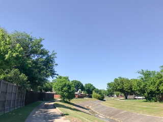 Typical residential neighborhood with an open air drainage canal in Dallas, Texas, USA
