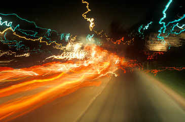 Wall Mural - Time exposure of highway lights at night