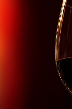 Close-up Of Wine Glass Against Colored Background
