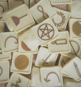 Witching Stones for Wicca interpretation of past, present and future. Piles of witching stones. Witchcraft and believe concept. On wooden background. Divination of fortune telling