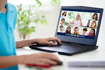 Online remote learning. School kids with computer.
