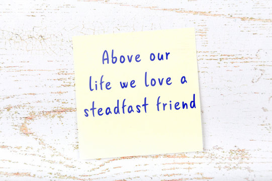 Yellow sticky note with handwritten motivational quote