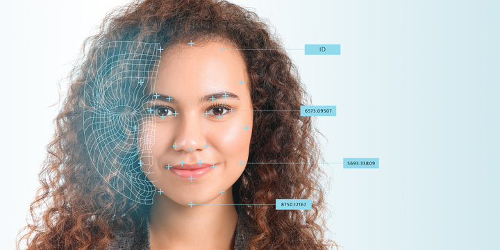 Young businesswoman using facial recognition system for data protection