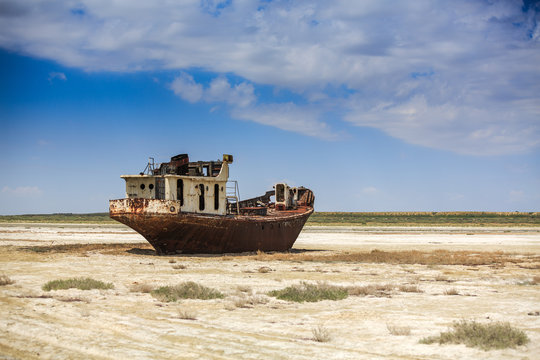 Old fishing schooner at the bottom of the dried Aral Sea