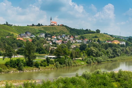 Summer rural landscape with the river Drava and Church of Sv. Marija in Malecnik near Maribor, Slovenia
