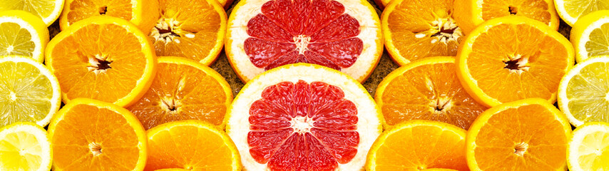 Fruit background banner panorama - cross section of citrus fruit on rustic wooden table