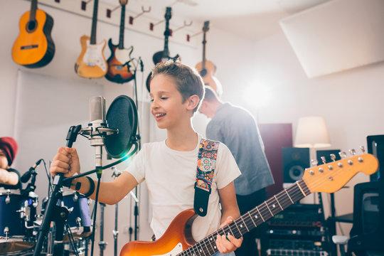 kids rock band practice in music studio