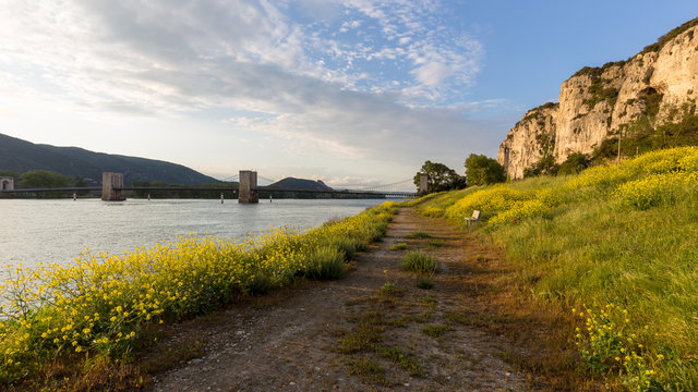 end of the day on the banks of the Rhone with a view of the cliffs of Donzere, France