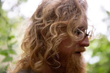 man with curly blonde hair and glasses
