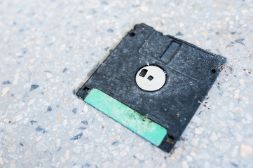Close-up Of Abandoned Floppy Disk On Footpath
