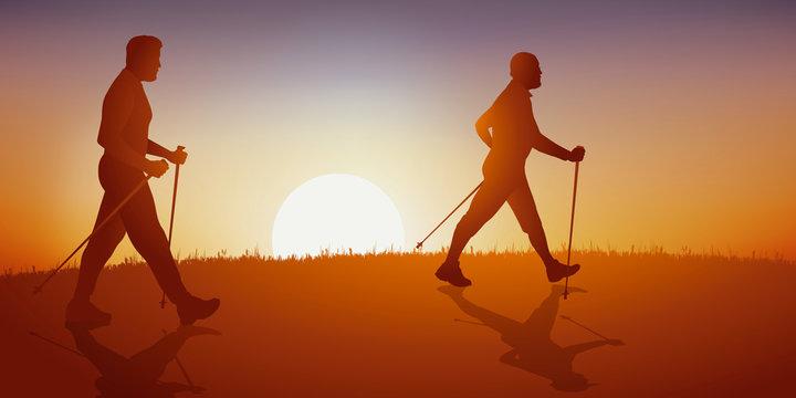 Concept de la randonnée avec deux hommes d'âges différents qui pratiquent la marche nordique sur un chemin de campagne.