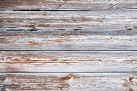 Old wooden texture with scratches and cracks.