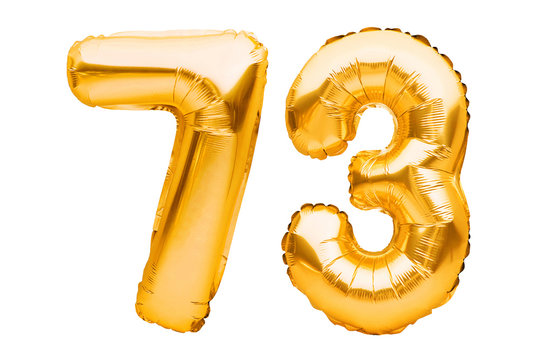 Number 73 seventy three made of golden inflatable balloons isolated on white. Helium balloons, gold foil numbers. Party decoration, anniversary sign for holidays, celebration, birthday, carnival