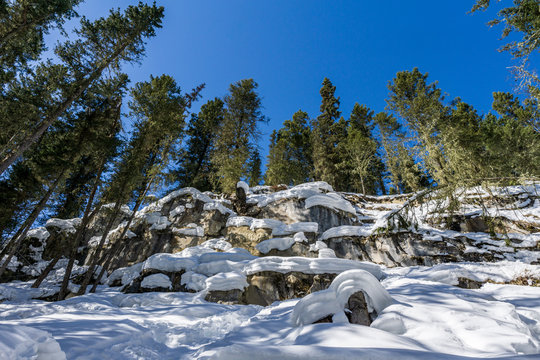 Wonderful Winter Landscape with snow and green trees blue sky at Sunny Day.