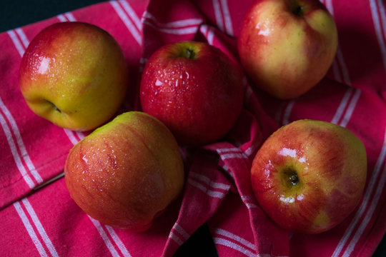Close-up Of Wet Apples With Table Cloth