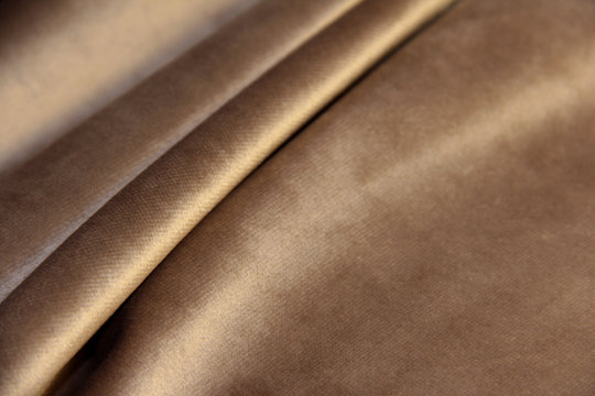 beige velour with pleats. Drapery on plush fabric