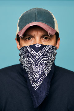 Close up portrait of a man wearing a bandana.