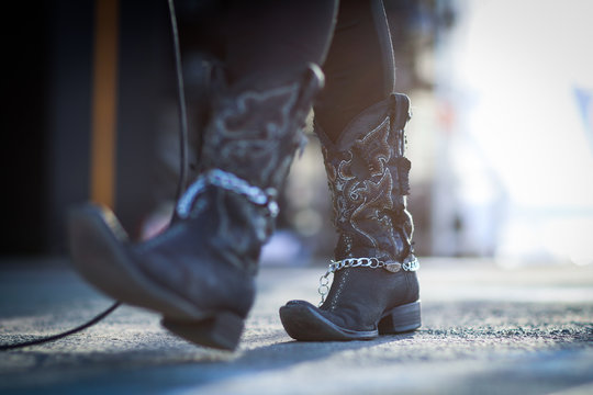 Low Section Of Woman Wearing Cowboy Boots