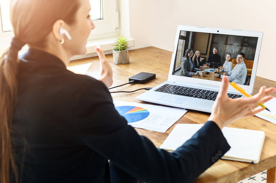 Job interview online. A young woman talks via video connection with employers