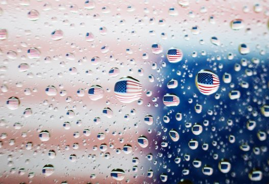 Full Frame Shot Of Water Drops On Window Against American Flag