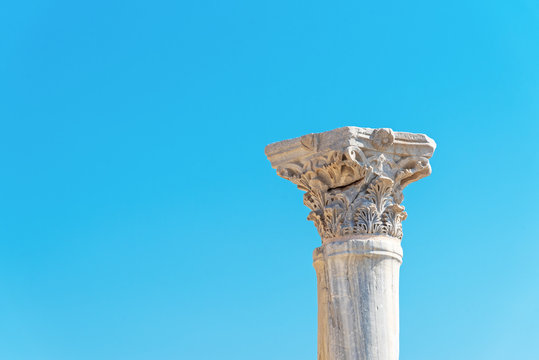 Antique column against the blue sky in the ancient city of Kourion (Cyprus)