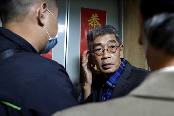 """Lam Wing-Kee waits for the elevator on the opening day of his bookstore """"Causeway Bay books"""" in Taipei"""