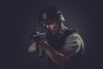 Army Soldier Aiming With Rifle Against Black Background