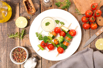 Wall Mural - vegetable barbecue skewer and sauce
