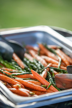 Catered tray of roasted carrots for a party ceremony