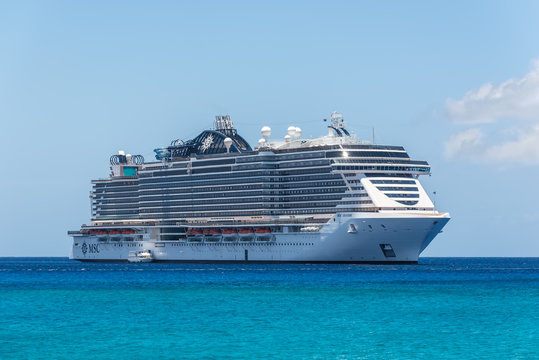 George Town, Grand Cayman Islands, United Kingdom - April 23, 2019: Cruise Ship MSC Seaside is anchored in front of the George Town city in the tropical Caribbean island of Grand Cayman, Cayman Island