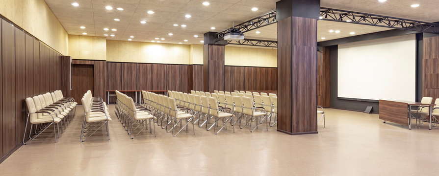 Presentation hall with columns. Preparations room for conference