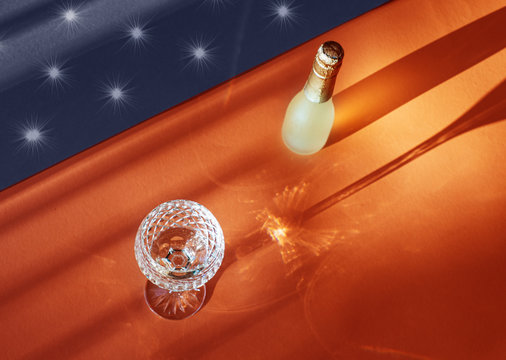 Independence Day (4th of July) celebration themed still life with a glass of champagne