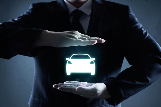 Digital Composite Image Of Businessman With Car Icon Against Gray Background