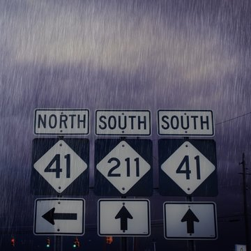 Close-up Of Road Sign During Monsoon