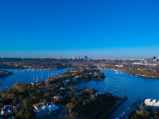 Printed kitchen splashbacks Australia Panoramic drone aerial view over Sydney harbour on a cloudy sunset showing the nice colours of the harbour foreshore