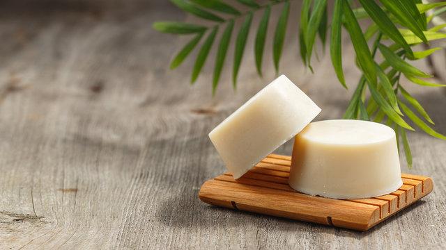 Eco friendly solid shampoo soap bar on wooden dish