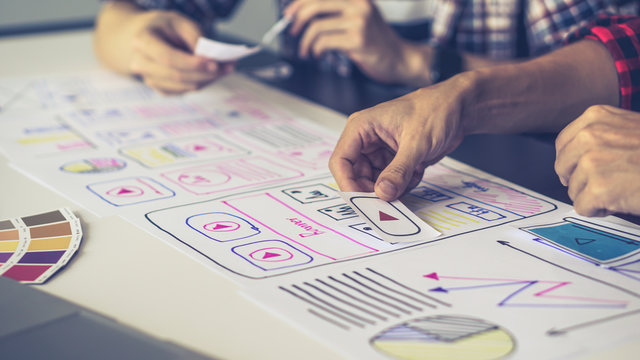 Designers man drawing (UX) (UI) Graphic designer creative sketch planning application process development prototype for application on smartphone. selective focus, copy space,