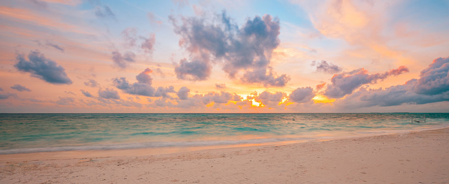 Sea sand sky concept, sunset colors clouds, peaceful horizontal background banner. Inspirational nature landscape, beautiful colors, wonderful scenery of tropical beach. Beach sunset, summer vacation