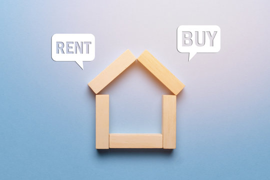 Concept of renting or buying real estate house made of wooden blocks with icons.