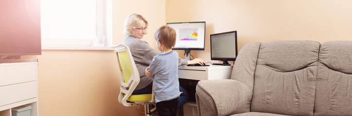 woman working at home with little child.