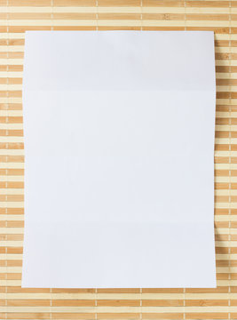 Directly Above Shot Of Blank Paper On Place Mat