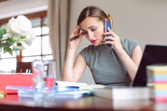 Businesswoman working from home during crisis being stressed